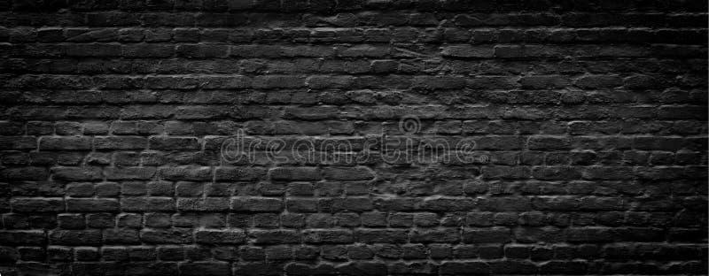 Black brick wall panoramic background stock photography