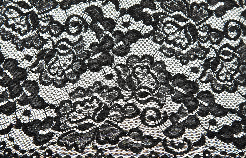 Background from black lace with pattern. With form flower on white royalty free stock image