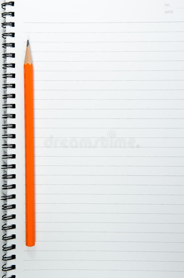 Background of blank book with orange pencil. On topview stock photos