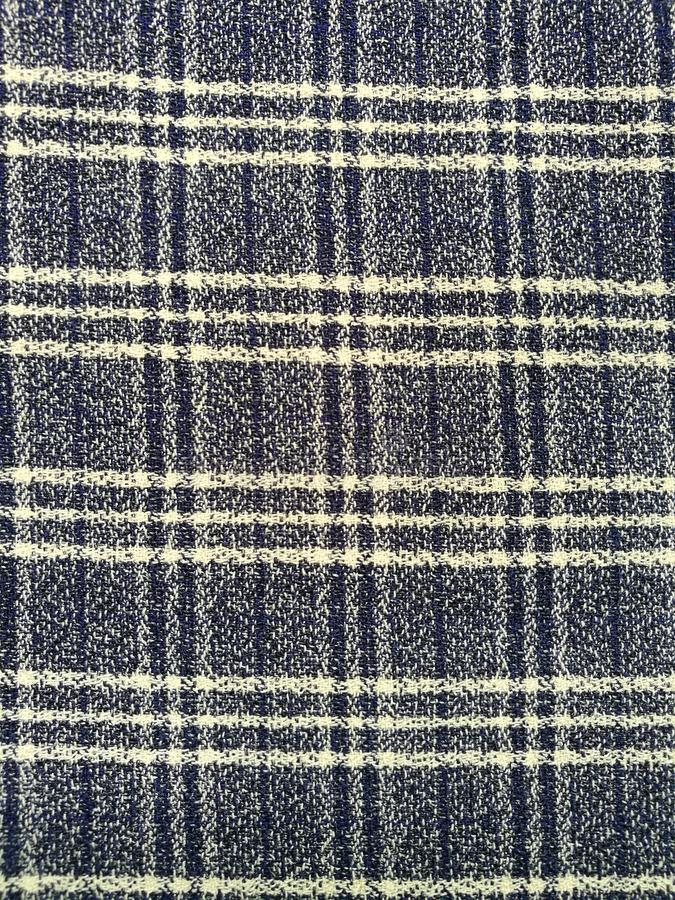 Checkered fabric texture pattern. Background of blue fabric texture with checkered pattern royalty free stock photography