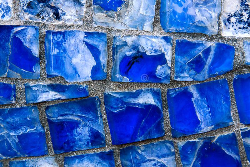 Background from blue mosaic, broken glass. Abstraction from blue mosaic broken glass. Horizontal pattern of blue street mosaic. Background from blue mosaic royalty free stock photo