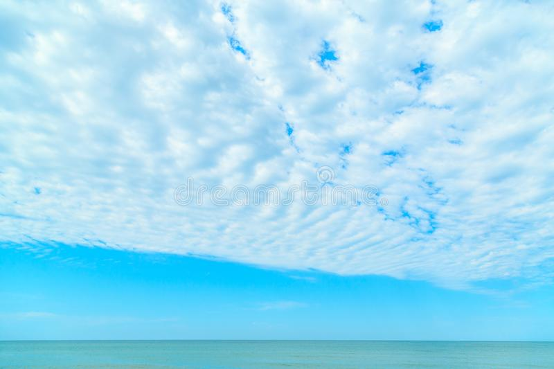 Background of blue sky with beautiful clouds and a small part of the azure sea in the frame. the focus is selective.  stock images