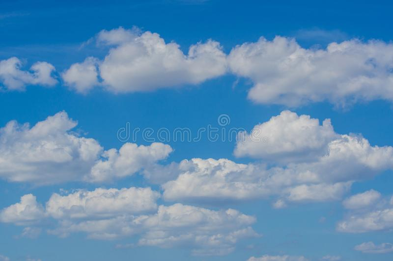 Background of blue sky with clouds. stock photo