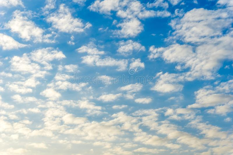 Background of blue sky full with clouds. Background of blue sky full with fluffy clouds day time cloudy scene stock photo