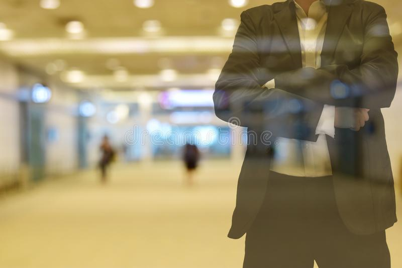 Background blur color tone warm in the morning. walkway Inside the building there are people. Foreground is a man wearing a suit. stock photos