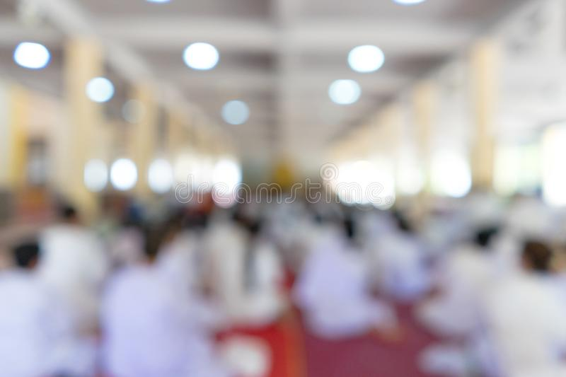 Background blur people worship buddha. In the temple royalty free stock image