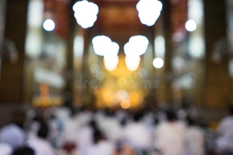 Background blur people worship buddha. In the temple royalty free stock images