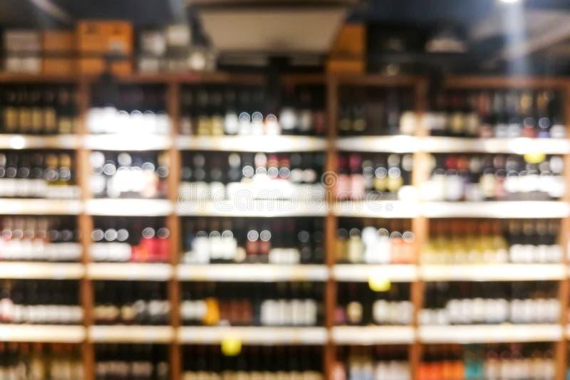 Background blur of wine shelf rack at retail store. Background blur of wine shelf rack at retail supermarket store, alcohol, bar, beverage, blurred, bokeh stock images