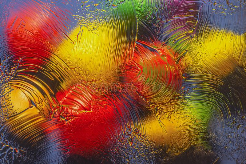 Background of blurry colored objects. Multi-colored objects depicted through the glass with smears of greasy ointment stock photo