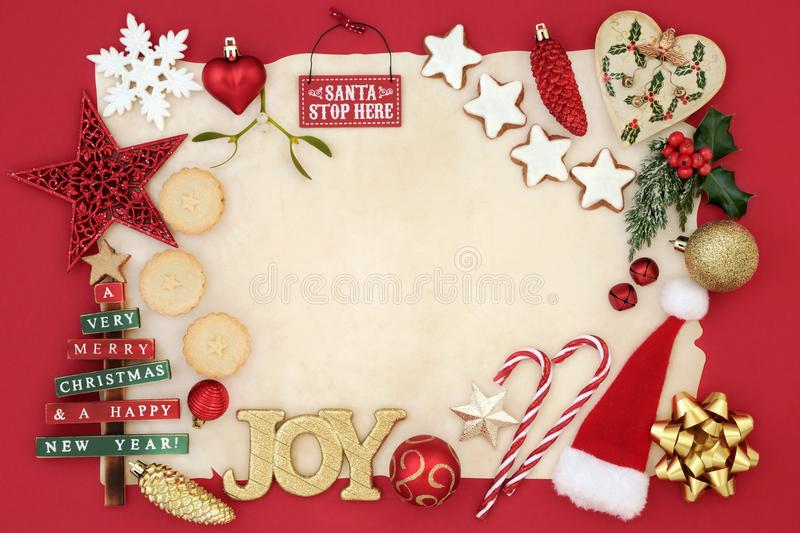 Background Border with Christmas Decorations. Christmas background border with bauble decorations, signs, mince pies, gingerbread cookies, holly, mistletoe and stock photos