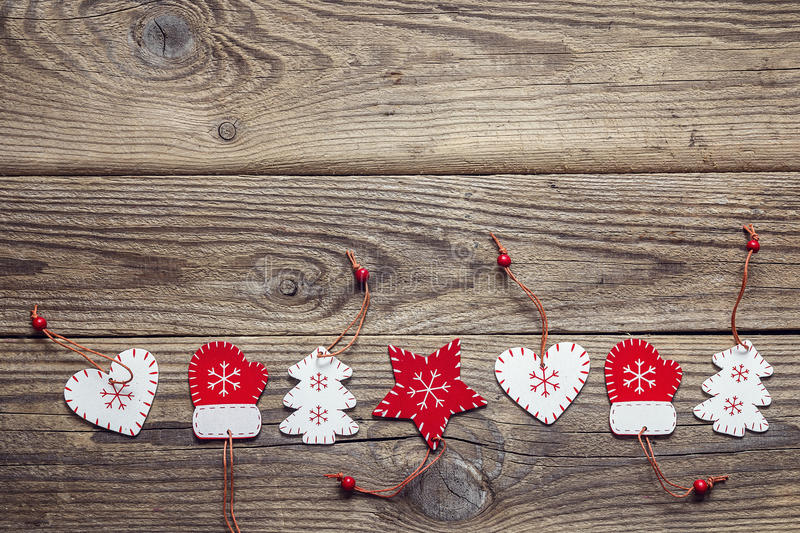 Background with a border of Christmas decorations on an old wood. En table. Space for text. Top view royalty free stock photo