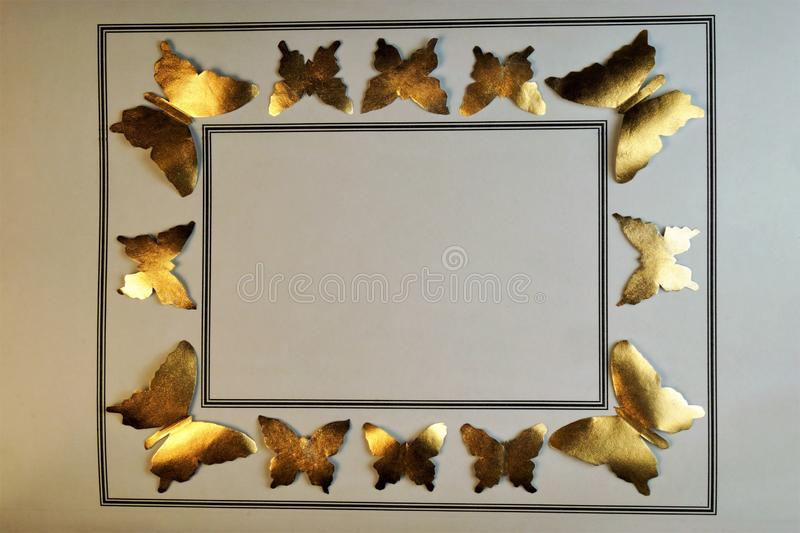 Background border frame made of gold butterflies stock photography