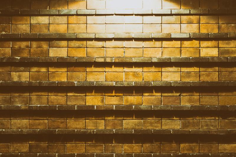 Background of brick wall illuminated from above by street lamp stock image