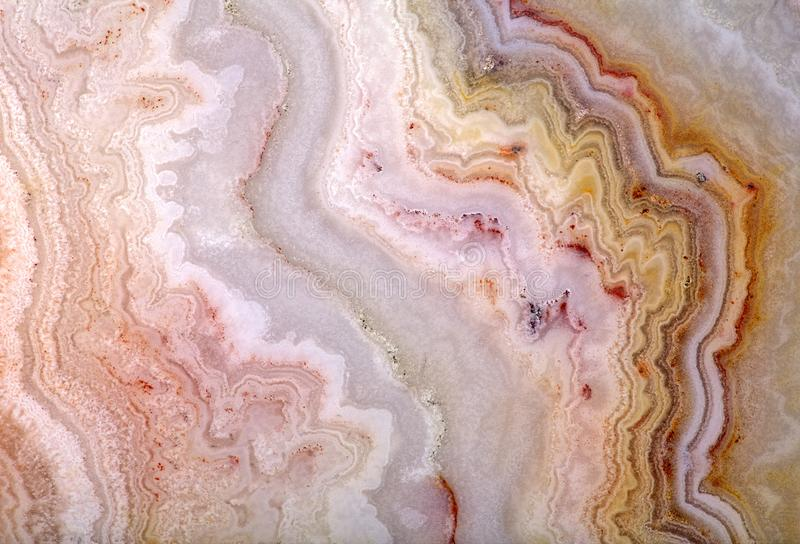 Light yellow wave agate structure. Background with bright color agate structure stock photo