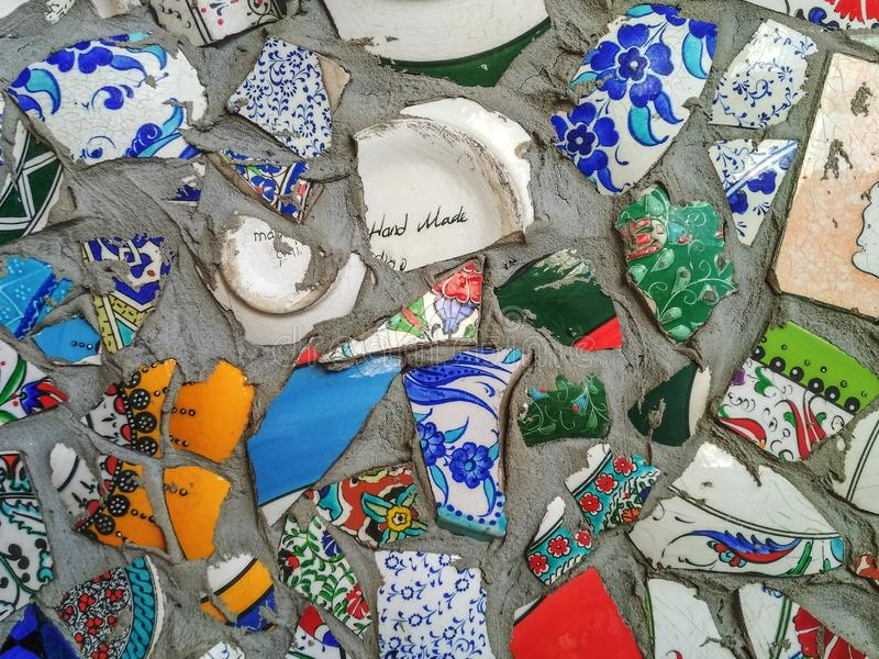Background with bright multi-colored shards of broken Turkish dishes stock photography
