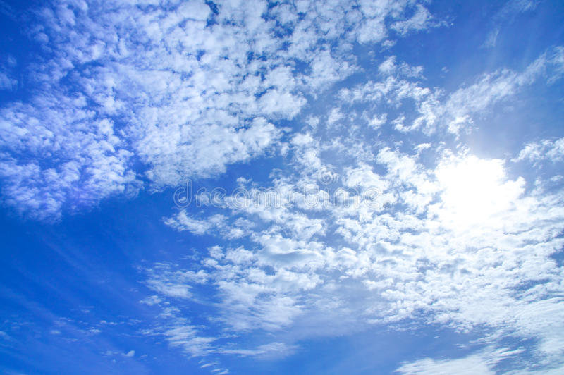 Background of bright sky blue colored sky with white cloud and sunshine stock images