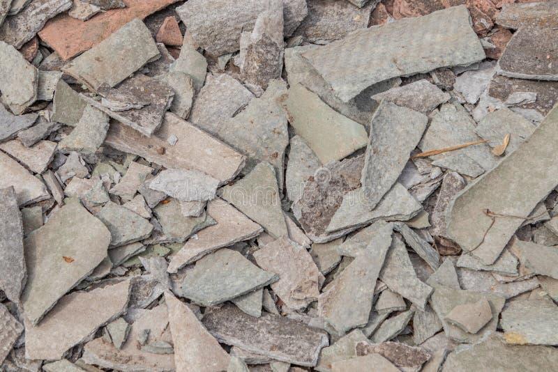 Background of broken gray wavy slate lying on the ground, close-up. Background of broken gray wavy slate lying on the ground. close-up stock images