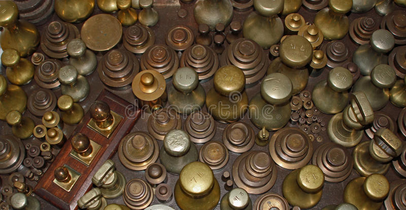 Background bronze weights. Symbolizing weight, measurements and antique retro objects stock images