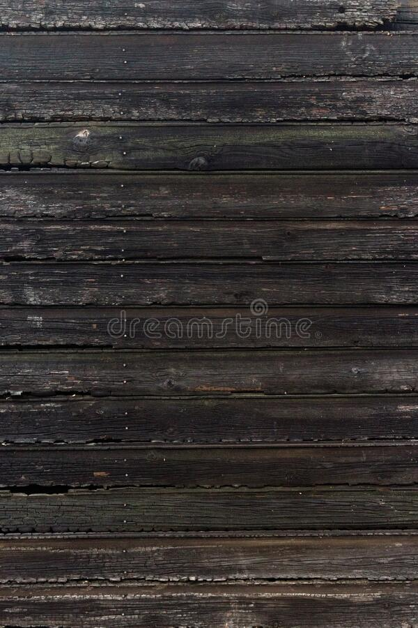 Background of the burned wall surface of wooden planks stock photo