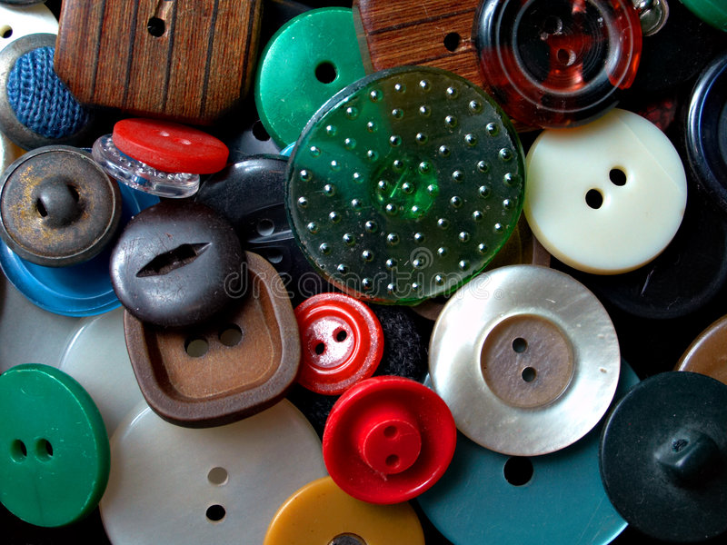 Background: buttons pile. Assorted buttons on black background stock photos