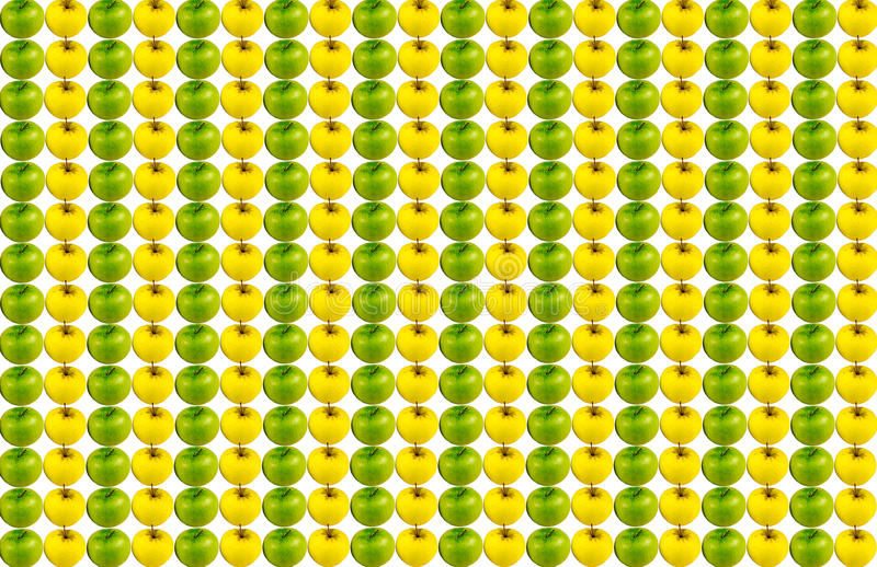 Background canvas vertical row of juicy green apple series of yellow fruits repeated without stopping. On a white basis stock photo