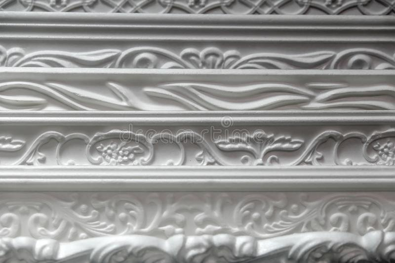Background of the ceiling plastic plinths. Apartment repair royalty free stock image