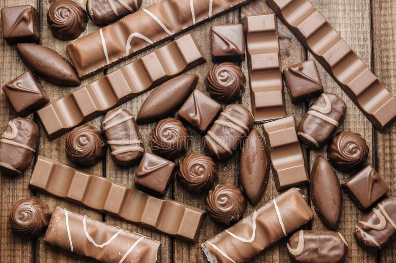 Background of chocolates, bars and sweets, free space for text royalty free stock photos
