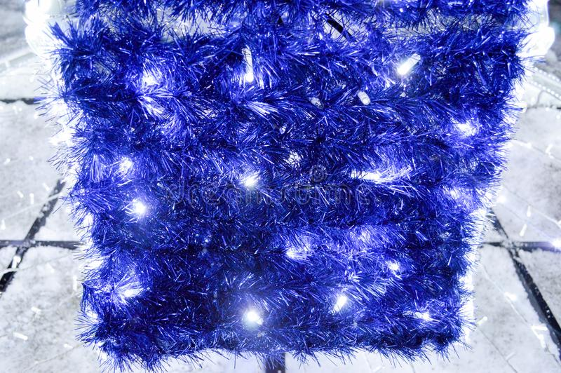 Background of Christmas decorations, lanterns, lights, garlands, blue rains. New Year`s background stock photography