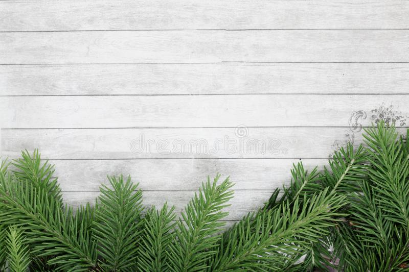 Background for christmas and new year, branches of spruce lie on a wooden background, space for text, festive background royalty free stock photos