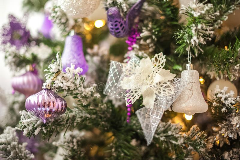 Background from a Christmas tree decorated in blue and purple close-up. Greeting card from a Christmas tree with purple decoration royalty free stock photo