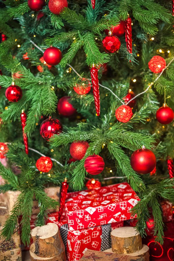Background from a Christmas tree decorated in red and gold color close-up. Greeting card from a Christmas tree with red decoration stock image