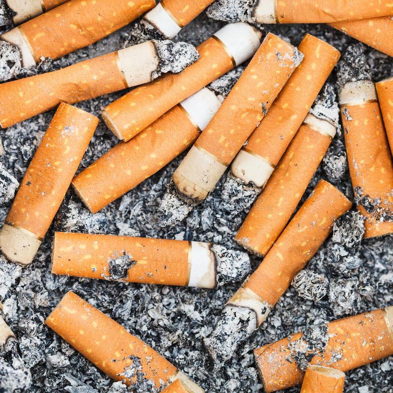 Background from cigarette stubs and ash stock photo