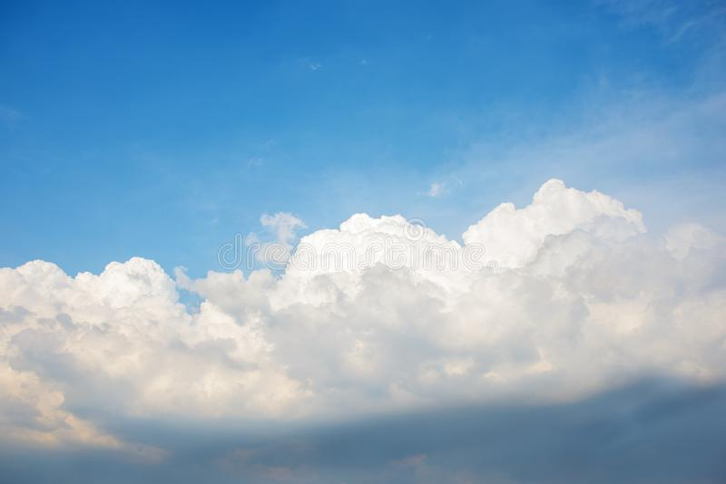 Background of the clear blue cerulean sky with big fluffy white cloud upon on it royalty free stock photography
