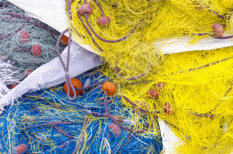 Colorful fishing nets in a pattern stock image