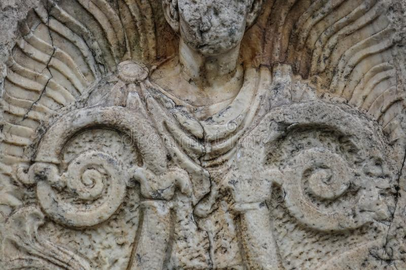 Background of closeup of beautiful Roman or Greek male stylized angel with cracks and face crumbled off - beautiful and grungy royalty free stock photo