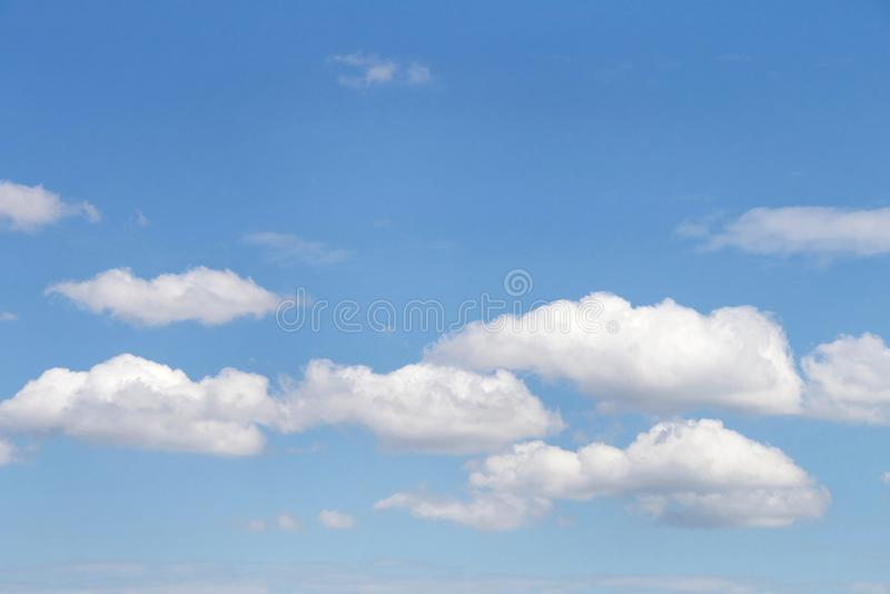 Background cloudscape cumulus clouds against a blue sky stock images