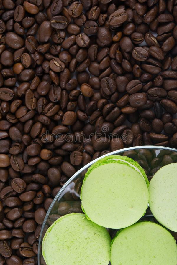 The background of coffee beans lie apple taste cookies, macaron stock photo