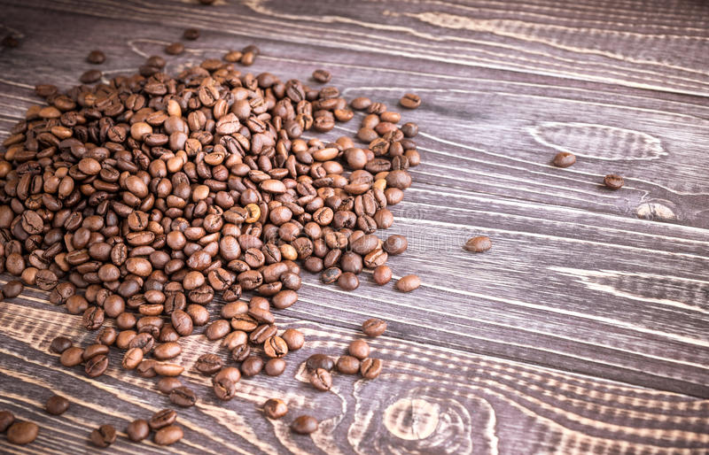 Background with coffee beans and wood texture royalty free stock photography