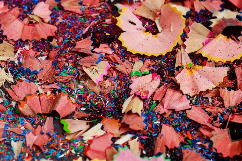 Colored graphite crumbs. Background of color pencil shavings a close-up royalty free stock image