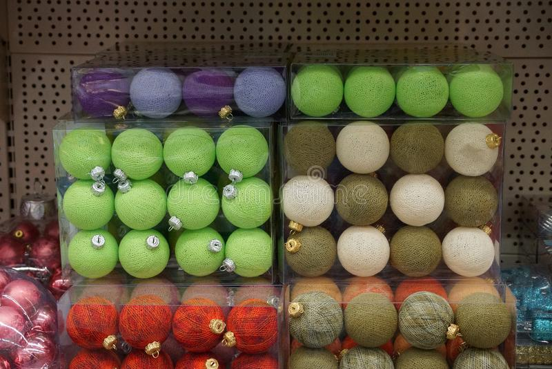 Background of colored christmas balls in a set in transparent packages royalty free stock images