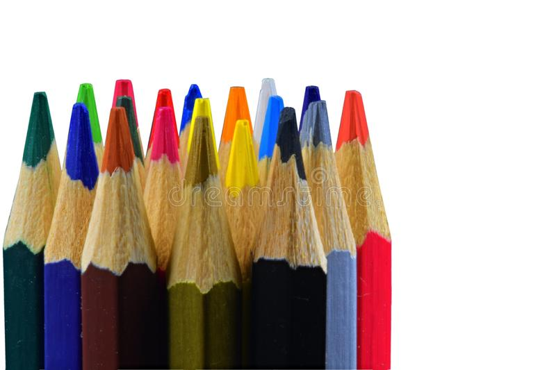 Background of colored pencils for creativity. Close up of an assortment of colored pencils tips on white background stock photography