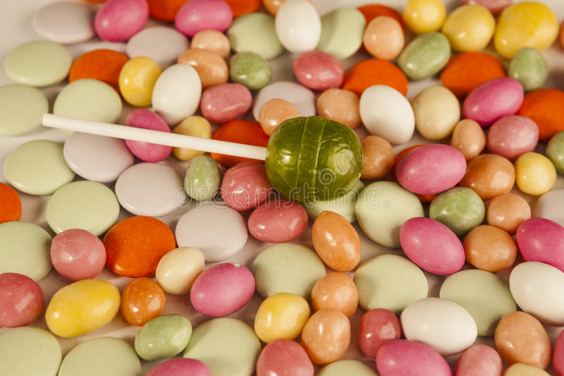 Background of colored small sweet candy and lolipop royalty free stock images