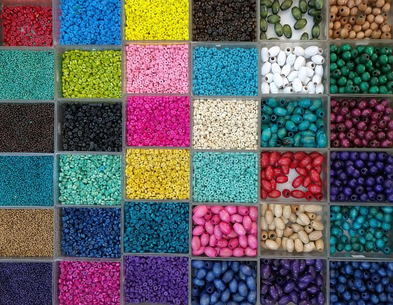 Background of colorful bright beads in boxes, set for needlework royalty free stock photo
