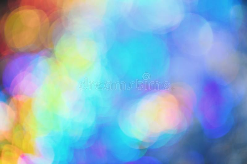 Background with colorful lights. Christmas light of all rainbow colors. Making blurred bubbles. Bokeh light vintage background, defocused. Abstraction concept stock photography