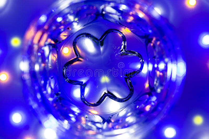 Background: Coloured Leds Bokeh. Various colored LED lights shot out of focus to create a nice bokeh effect. Sot through a glass with a symetrical pattern stock image
