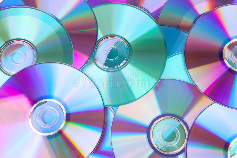 Background of compact disc-CDs. Background made out of compact discs CDs in closeup stock images