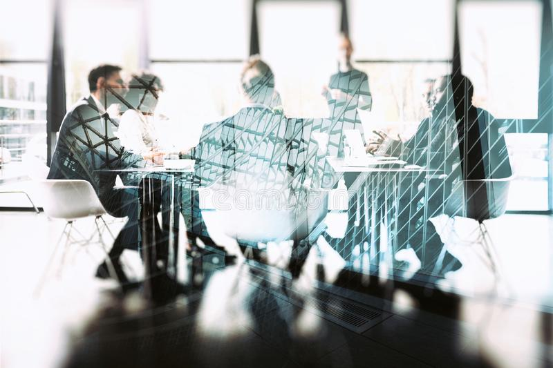 Background concept with business people sitting at the meeting table in the office near a window glass. Double exposure stock images