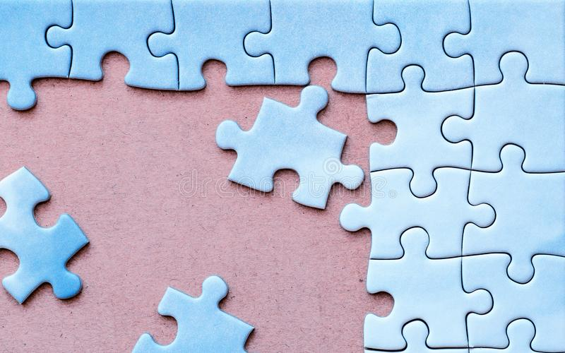 Background with connected pieces of blue puzzle. stock photos
