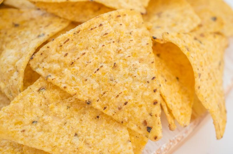 Background of corn tortillas or Nachos fried on open fire. Copy space. Close up.  stock image