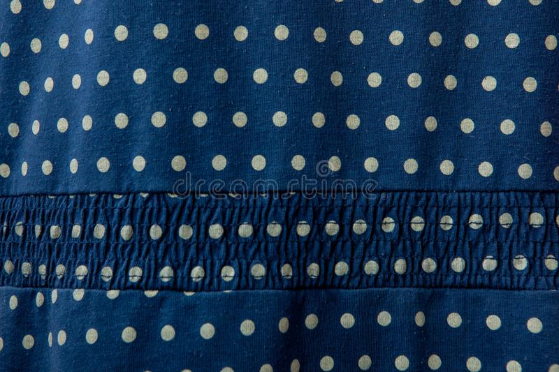 Background cotton blue fabric with head pattern stock photos